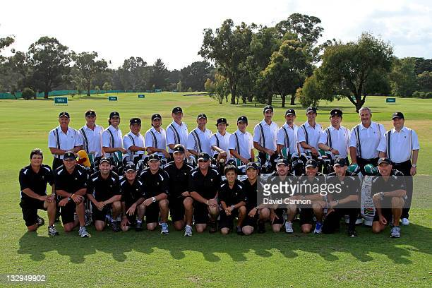 Members of the International Team and their caddies pose for a team photo prior to the start of the 2011 Presidents Cup at Royal Melbourne Golf...