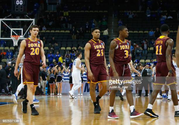Members of the Iona Gaels walk off the court defeated after their 6789 loss to the Duke Blue Devils in the game during the first round of the 2018...
