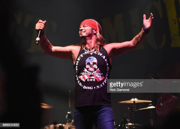 Members of The Iowa National Guard Tasha Throndson Andrew V Johnson Matt Pentico Grant Lehman and Symone Frakes join Bret Michaels on stage at Tree...