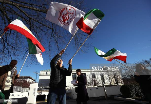 Members of the Iranian American Community of Washington, gather in front the State Department to celebrate the death of Iranian military leader...