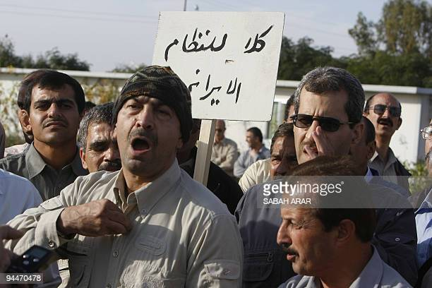 Members of the Iranian oppposition group People's Mujahedeen which fought with Saddam Hussein's regime against Iran in the 198088 war protest on...