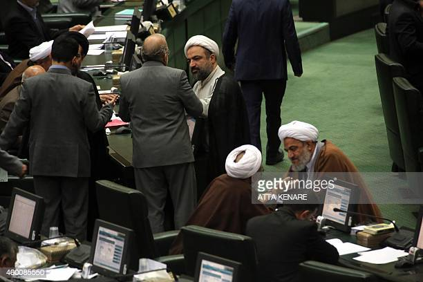 Members of the Iranian parliament arrive before Iranian President Hassan Rouhani presented the proposed annual budget in Tehran on December 7 2014...