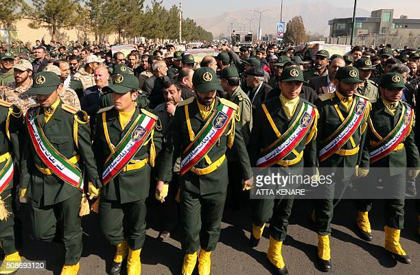 Members of the Iranian Revolutionary Guard carry the casket of Iran's Revolutionary Guards Brigadier General Mohsen Ghajarian who was killed in the...