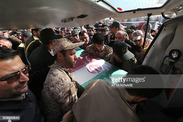 Members of the Iranian Revolutionary Guard carry the caskets of Iran's Revolutionary Guards Brigadier General Mohsen Ghajarian and other Iranian...