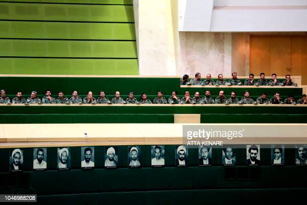 Members of the Iranian Revolutionary Guard listen to a speech in parliament in Tehran on October 7 over the a bill to counter terrorist financing The...