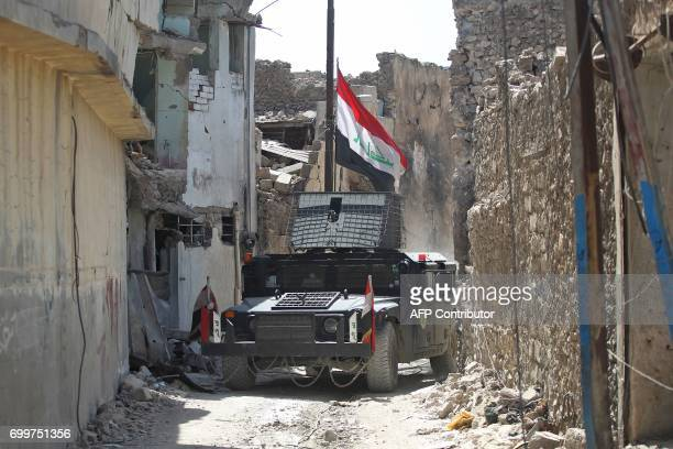 Members of the Iraqi antiterrorism forces advance in the Old City of Mosul on June 22 during the ongoing offensive by Iraqi forces to retake the last...