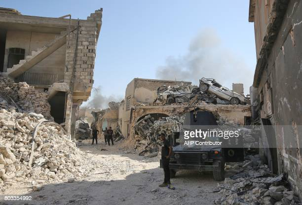 Members of the Iraqi CounterTerrorism Service advance towards the Grand Mosque of Nuri in the Old City of Mosul on June 29 during the ongoing...