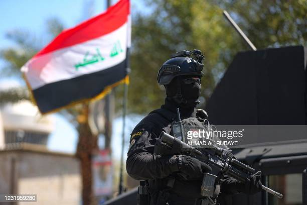Members of the Iraqi Counter-terrorism Service are deployed in the streets of the capital Baghdad on March 27 days after a military parade by an...