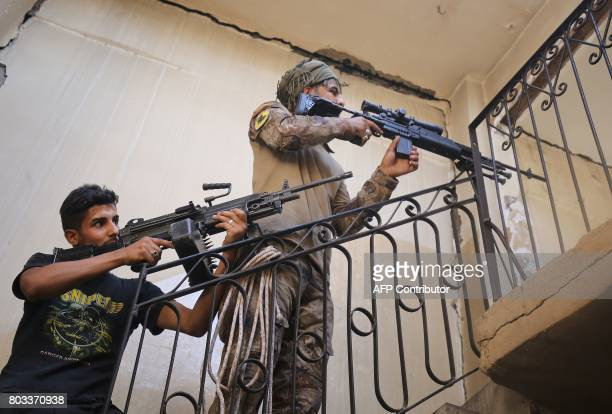 Members of the Iraqi CounterTerrorism Service ascend a staircase as they clear a building while advancing towards the Grand Mosque of Nuri in the Old...