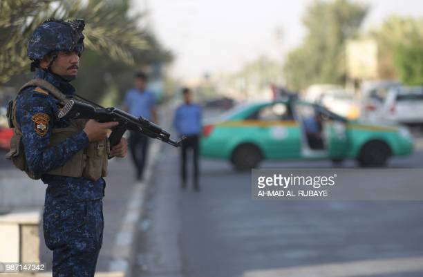 A members of the Iraqi Federal Police patrols the streets of Baghdad's Shula district as part of inforced security measures taken by the government...