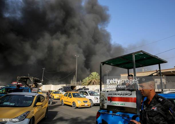 TOPSHOT Members of the Iraqi federal police stand outside the country's biggest ballot warehouse where votes for the eastern Baghdad district were...