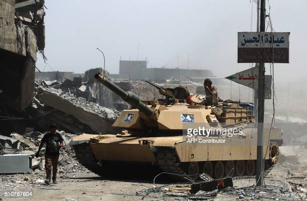 Members of the Iraqi federal police tank is seen in the Old City of Mosul on July 8 as their part of the battle has been declared accomplished while...