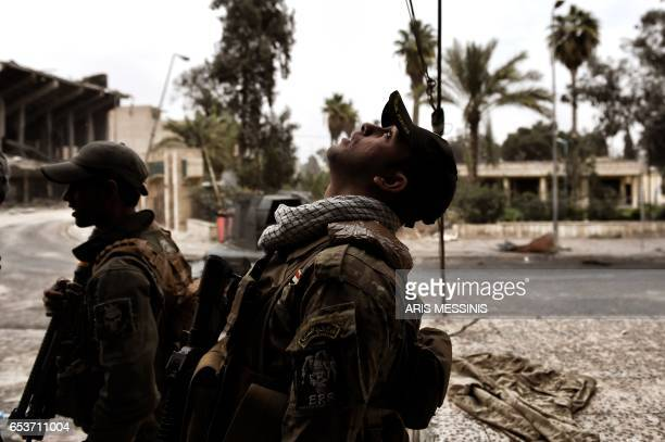TOPSHOT Members of the Iraqi forces attempt to fly a drone to spot positions of Islamic State group jihadists in the northern Iraqi city of Mosul on...