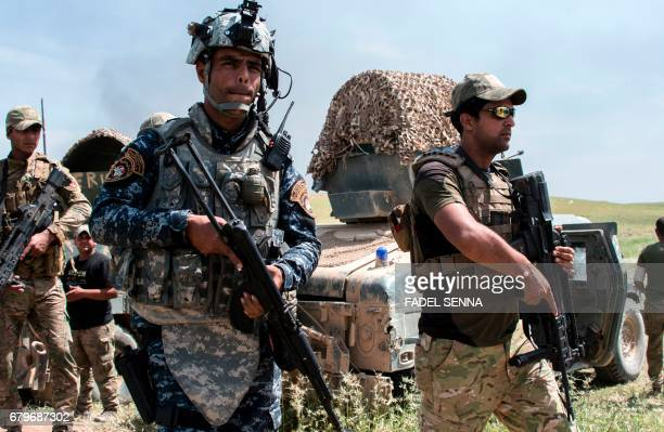 Members of the Iraqi forces' Emergency Response Division advance on the frontlines in west Mosul on May 6 during the offensive to retake the area...