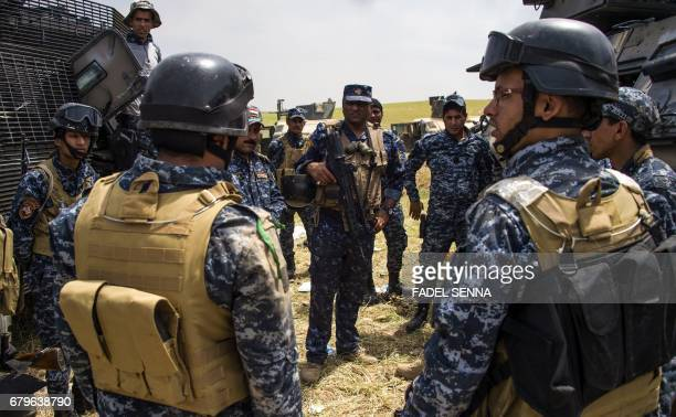 Members of the Iraqi forces' Emergency Response Division regroup during their advance on the frontlines in west Mosul on May 6 as the offensive...