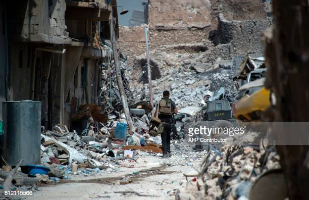 TOPSHOT Members of the Iraqi forces in the Old City of Mosul on July 10 during the offensive to retake the embattled city from Islamic State group...