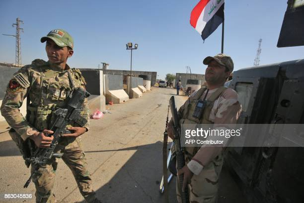 Members of the Iraqi government's Emergency Response Brigade stand guard at the Bai Hassan oil field west of the multiethnic northern Iraqi city of...