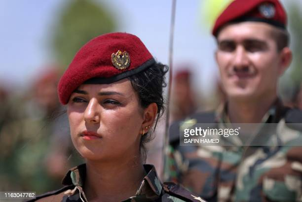 Members of the Iraqi Kurdish Peshmerga forces attend a ceremonial line-up during a training session by German military officers during the German...