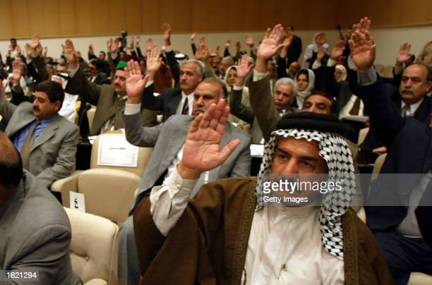 Members of the Iraqi parliament vote during the parliament session to decide a response to the latest UNited Nations resolution November 12 2002 in...