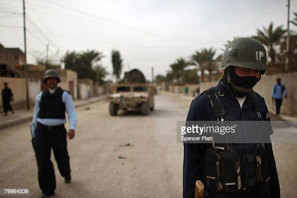 Members of the Iraqi Police participate in a joint patrol with members of the US Army February 24 2008 in Diyala Province Baquba Iraq Baquba was...