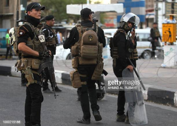 Members of the Iraqi security forces are deployed in the capital Baghdad's Tahrir Square during demonstrations against unemployment on July 16 2018...