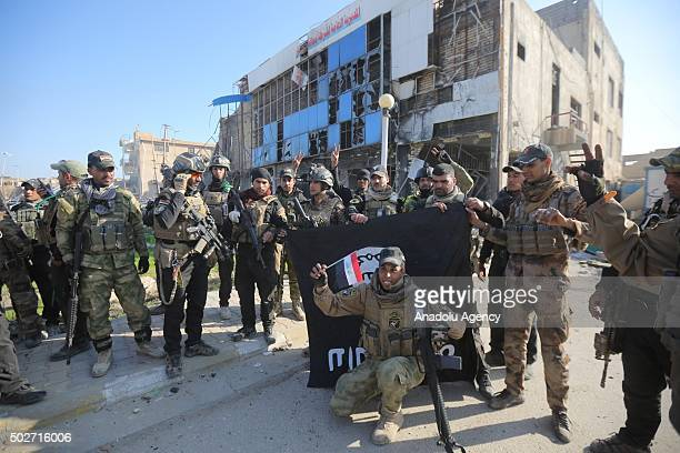 Members of the Iraqi security forces celebrate after retaking Ramadi city from Daesh in Ramadi Iraq on December 28 2015