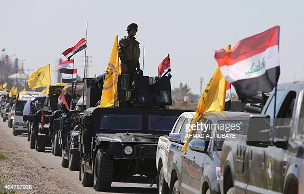Members of the Iraqi security forces heading from the city of Samarra north of Baghdad drive towards alDawr area south of Tikrit to launch an assault...