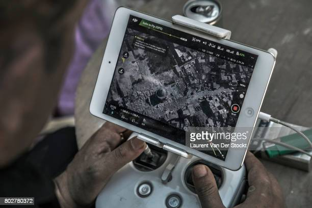 Members of the iraqi special forces observe the the AlNuri mosque area with a drone before attempting to retake it from the Islamic State The Iraqi...