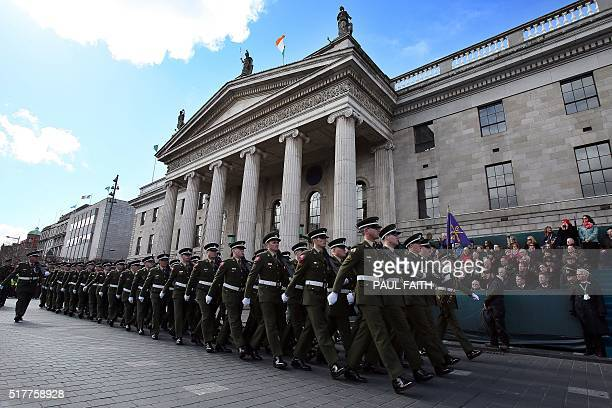 Members of the Irish army march past the General Post Office , the scene of the 1916 Easter Rising, in Dublin on March 27, 2016 during a programme of...