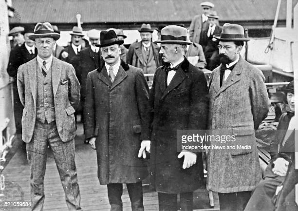 Members of the Irish delegation at Kingstown en route to London as part of the negotiations that led to the AngloIrish Treaty circa December 1921 LR...