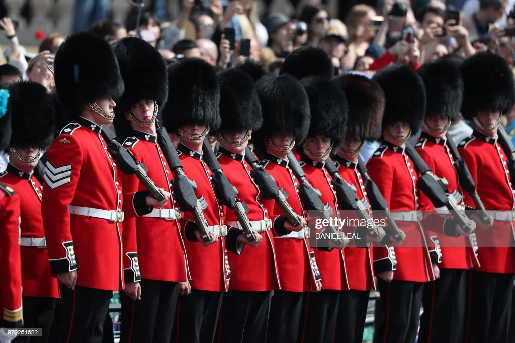 TOPSHOT - Members of the Irish Guards, a regiment of Household Division, march to Horseguards parade ahead of the Queen's Birthday Parade, 'Trooping the Colour', in London on June 9, 2018. - The ceremony of Trooping the Colour is believed to have first been performed during the reign of King Charles II. In 1748, it was decided that the parade would be used to mark the official birthday of the Sovereign. More than 600 guardsmen and cavalry make up the parade, a celebration of the Sovereign's official birthday, although the Queen's actual birthday is on 21 April.