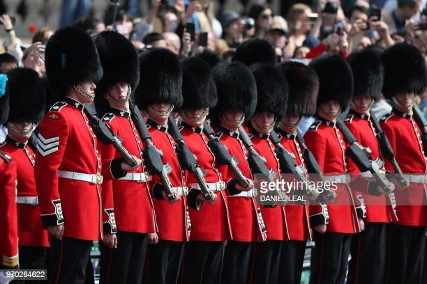 TOPSHOT Members of the Irish Guards a regiment of Household Division march to Horseguards parade ahead of the Queen's Birthday Parade 'Trooping the...