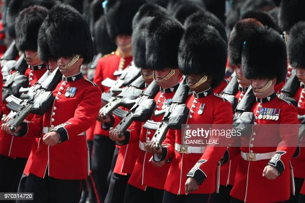 Members of the Irish Guards a regiment of Household Division march to Horseguards parade ahead of the Queen's Birthday Parade 'Trooping the Colour'...