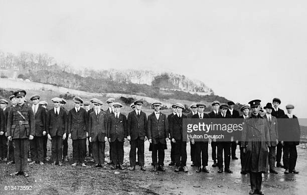 Members of the Irish Republican Army stand to attention during a parade at Moville in County Donegal