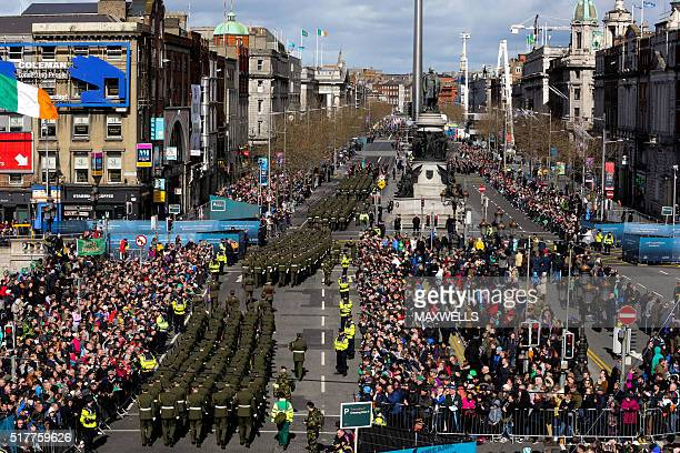 Members of the Irish security services march through central Dublin on March 27, 2016 as part of the programme of commemorative events to mark the...