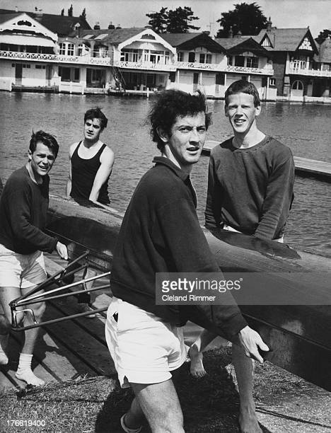 Members of the Isis Boat Club at Henley Royal Regatta on the Thames in Oxfordshire, 5th July 1965.