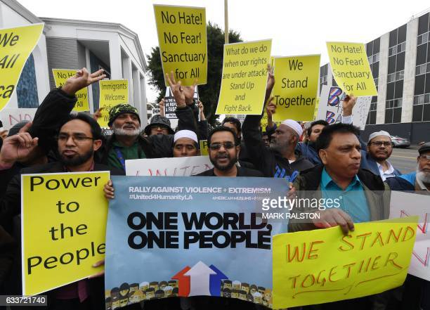 Members of the Islamic community protest during a solidarity rally held in conjunction with interfaith religious leaders as they respond to President...
