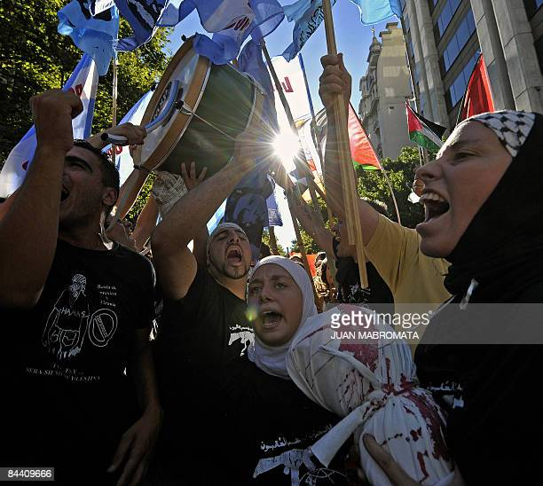Members of the Islamic community shout slogans supporting Palestine against Israeli military action in the Gaza Strip in front of the Israeli Embassy...