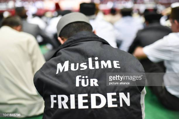 Members of the Islamic religious community Ahmadiyya Muslim Jamaat praying at the dmArena Rheinstetten Germany 02 September 2016 A man can be seen...