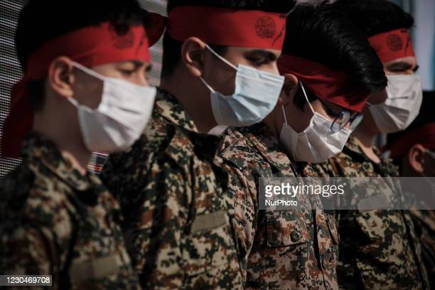 Members of the Islamic Revolutionary Guard Corps perform while attending a ceremony to mark the death anniversary of the former Islamic Revolutionary...
