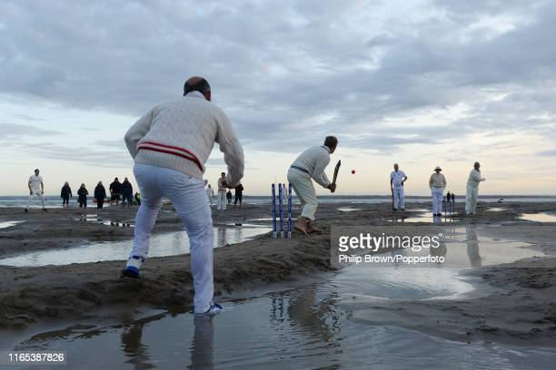 Members of the Island Sailing Club and the Royal Southern Yacht Club play cricket on The Brambles sand bank at low tide in the Solent on September 1...
