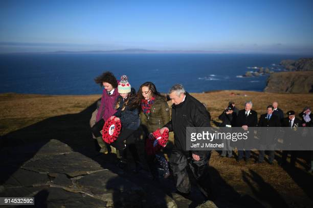 Members of the Islay community lay wreaths as they hold a commemorative service at the American Monument on February 5 2018 in Islay Scotland As part...