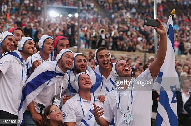 Members of the Israeli national team shoot selfies upon their arrival at the official opening ceremony of the European Maccabi Games at the...