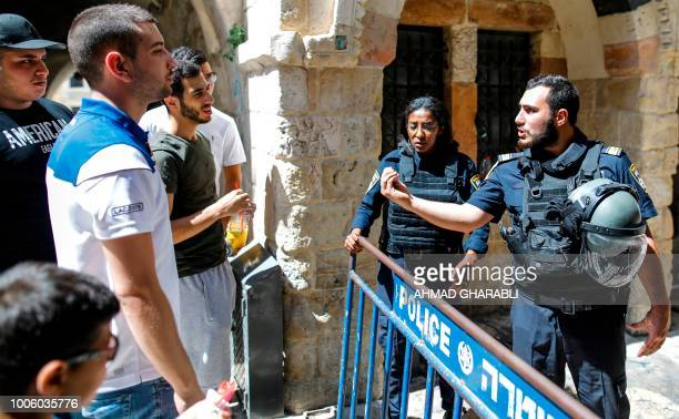Members of the Israeli security forces close down a street in the Old City of Jerusalem on July 27 2018 after clashes that took place earlier in the...