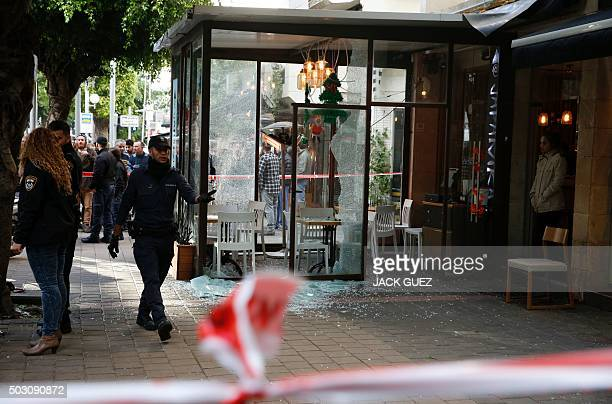 Members of the Israeli security forces cordon off the area following an attack by an unidentified gunman who opened fire at a pub in the Israeli city...