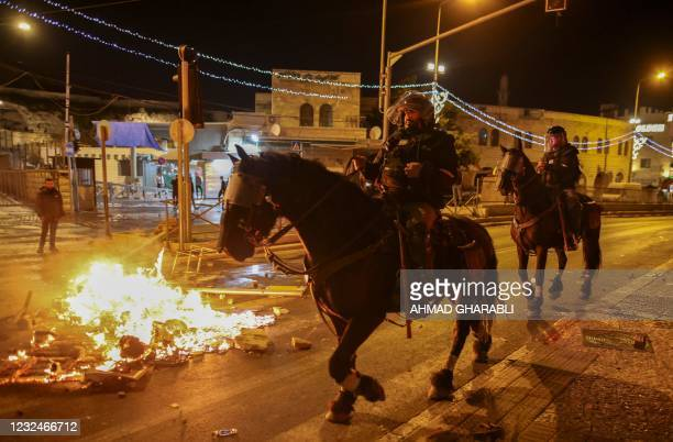 Members of the Israeli security forces deploy during clashes with Palestinian protesters outside the Damascus Gate in Jerusalem's Old City on April...