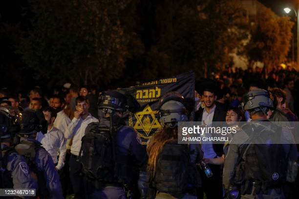 Members of the Israeli security forces stand guard as Jewish protesters gather outside the Damascus Gate in Jerusalem, April 22, 2021.