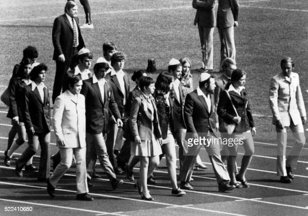 Members of the Israeli team march on the field of the Munich Olympic stadium on September 06, 1972 to attend the memorial ceremony paying tribute to...
