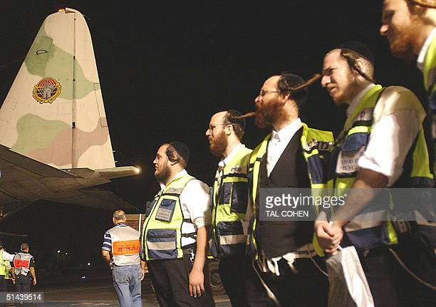 Members of the Israeli Zaka emergency service wait 08 October 2004 to cross into Egypt from the southern Israeli town of Eilat following a series of...