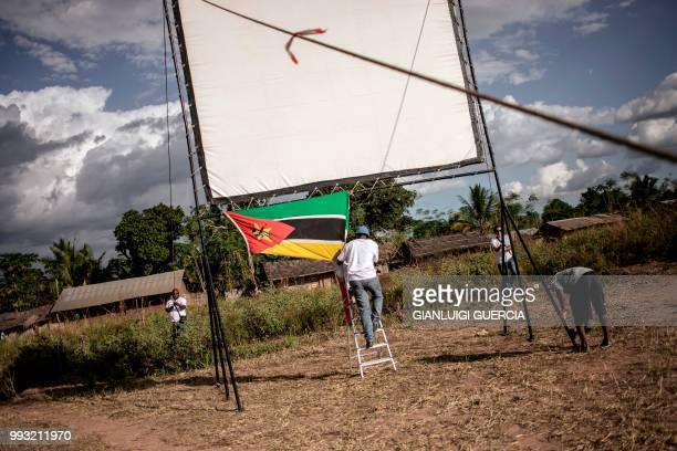 Members of the Italian Agency for Cooperation and development and Mozambican Filmmakers collective AMOCINE set up a giant screen for a public view of...